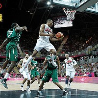 02 August 2012: USA Russell West slides in the air looking to pass the ball during 156-73 Team USA victory over Team Nigeria, during the men's basketball preliminary, at the Basketball Arena, in London, Great Britain.
