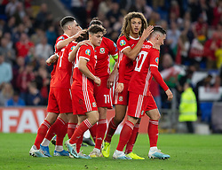 CARDIFF, WALES - Friday, September 6, 2019: Wales Daniel James and Ethan Ampadu celebrate their side's opening goal during the UEFA Euro 2020 Qualifying Group E match between Wales and Azerbaijan at the Cardiff City Stadium. (Pic by Mark Hawkins/Propaganda)