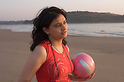 Woman with a red ball, Goa, India