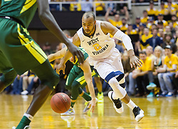 Jan 10, 2017; Morgantown, WV, USA; West Virginia Mountaineers guard Jevon Carter (2) picks up a loose ball during the second half against the Baylor Bears at WVU Coliseum. Mandatory Credit: Ben Queen-USA TODAY Sports