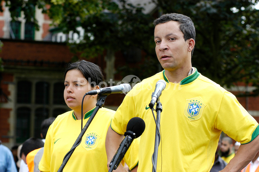 Patricia Armani and Alex Pereira; cousins of Jean Charles de Menezes; speaking at a rally to protest against the raid of a house in Forest Gate by the anti terrorist police; June 2006 London