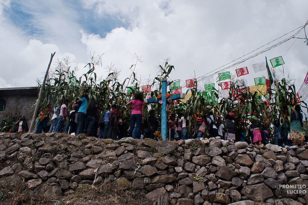 Women climb and dance in the Tlatlatzohuaya (Hill of the Cross) to show gratitude for the rain times that helped the harvest of corn.  (Photo: Prometeo Lucero)