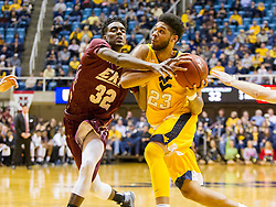 Dec 21, 2015; Morgantown, WV, USA; West Virginia Mountaineers forward Esa Ahmad (23) is fouled by Eastern Kentucky Colonels guard Ja'Mill Powell (32) while driving to the hoop during the second half at the WVU Coliseum. Mandatory Credit: Ben Queen-USA TODAY Sports