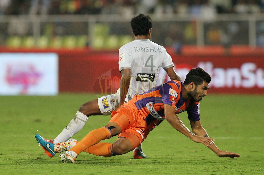 Kinshuk Debnath of Atletico de Kolkata and Joaquim Abranches of FC Pune City collide during match 44 of the Hero Indian Super League between FC Pune City and Atletico de Kolkata FC held at the Shree Shiv Chhatrapati Sports Complex Stadium, Pune, India on the 29th November 2014.<br /> <br /> Photo by:  Vipin Pawar/ ISL/ SPORTZPICS