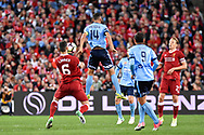 May 24, 2017: Sydney FC forward Alex BROSQUE (captain) (14) goes up for the ball at the soccer match, between English Premiere League team Liverpool FC and Sydney FC, played at ANZ Stadium in Sydney, NSW Australia.