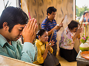 25 FEBRUARY 2015 - PHNOM PENH, CAMBODIA: People pray in a shrine on Sisowath Quay in front of the Royal Palace in Phnom Penh.    PHOTO BY JACK KURTZ