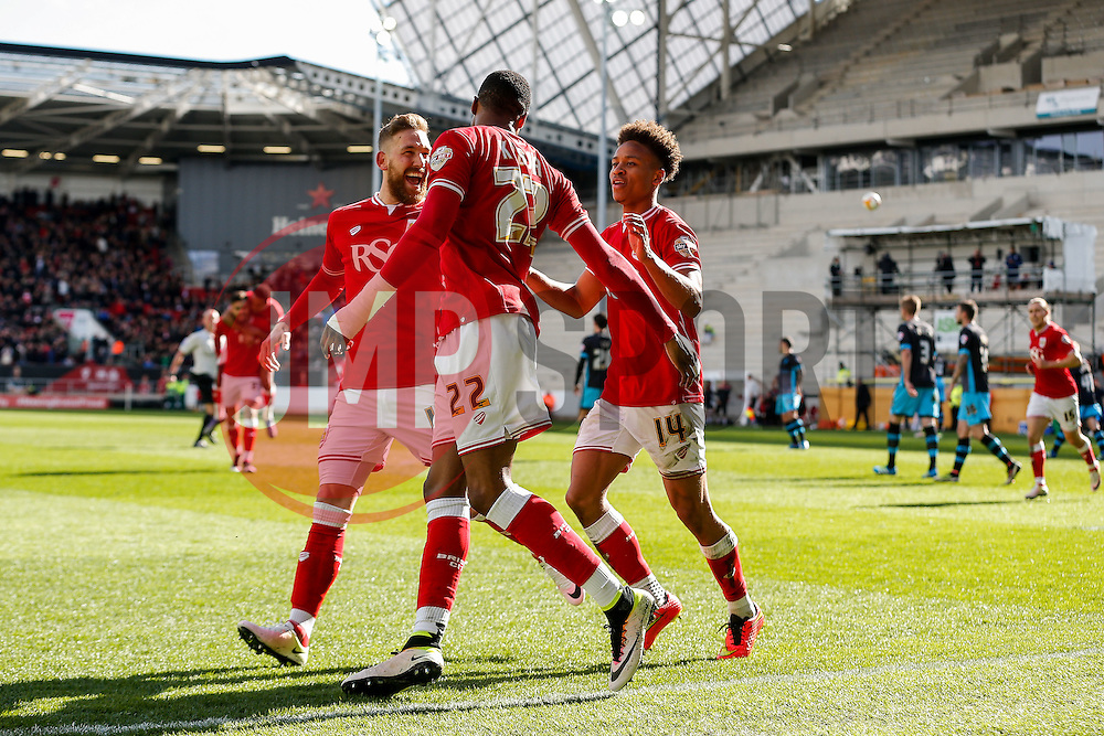 Jonathan Kodjia of Bristol City celebrates with Scott Wagstaff and Bobby Reid after scoring a goal from the penalty spot to make it 4-0 - Mandatory byline: Rogan Thomson/JMP - 09/04/2016 - FOOTBALL - Ashton Gate Stadium - Bristol, England - Bristol City v Sheffield Wednesday - Sky Bet Championship.
