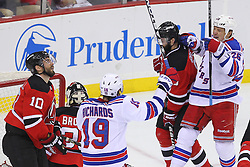 May 25, 2012; Newark, NJ, USA; New York Rangers left wing Ruslan Fedotenko (26) celebrates his goal on New Jersey Devils goalie Martin Brodeur (30) during the second period in game six of the 2012 Eastern Conference finals at the Prudential Center.