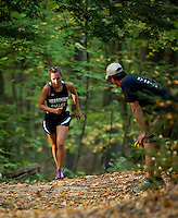Encouraged by Coach Jeff Neilsen McKenzie Haney makes her way up the final hill during Tuesday's Cross Country meet at MVHS.   (Karen Bobotas/for the Concord Monitor)