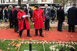 © Licensed to London News Pictures. 04/11/2015. London, UK. A Chelsea pensioner takes a photograph of the field of remembrance before a service to mark the opening of the Filed of Remembrance at Westminster Abbey, attended by Prince Philip, Duke of Edinburgh and Prince Harry.  The Field of remembrance is a memorial garden to commemorate British and Commonwealth military and civilian servicemen and women in the two World Wars and later conflicts. Photo credit: Ben Cawthra/LNP
