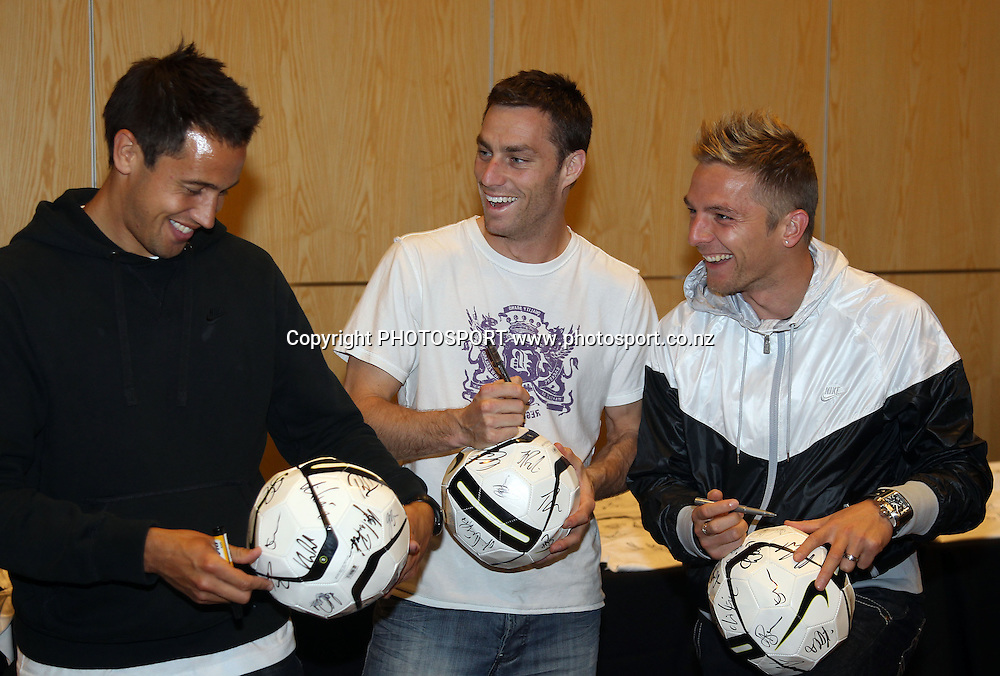(L to R) Jeremy Christie, Andy Barron and David Mulligan, The New Zealand All Whites football team sign merchandise during a signing session at Sky City in Auckland. 19 May 2010. Photo: Andrew Cornaga/PHOTOSPORT
