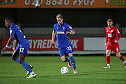 AFC Wimbledon midfielder Mitchell (Mitch) Pinnock (11) dribbling during the Leasing.com EFL Trophy match between AFC Wimbledon and Leyton Orient at the Cherry Red Records Stadium, Kingston, England on 8 October 2019.