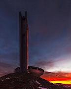 Neglected communist memorial at sunrise
