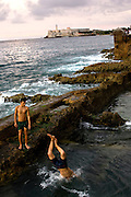 Boys swim in El Malecon waterway in Havana, Cuba, and dream of escaping by boat to Florida. Many Cubans have made multiple attempts to leave.