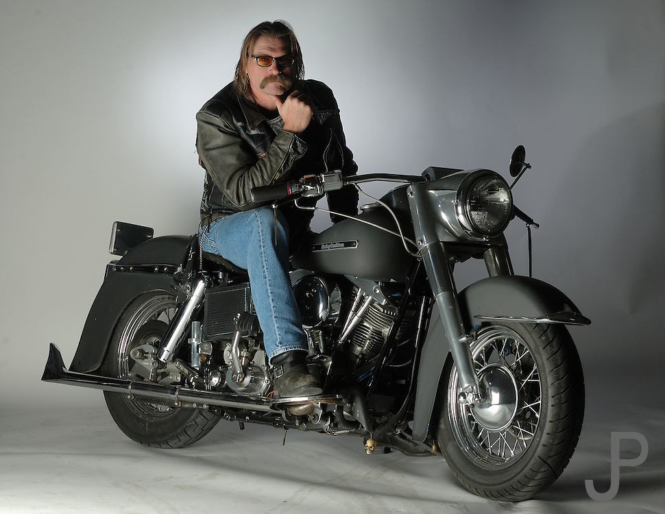 Steve Capps, a member of the Wind & Fire motorcycle club member on his custom Harley Davidson motorcycle.  Wind & Fire club consists of fireman who ride Harley Davidson motorcycles.