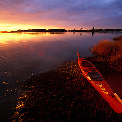 A kayak and sunrise in Little Harbor in Rye, New Hampshire.  Rye, NH