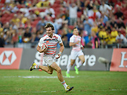 England's Harry Glover makes a break to score during the HSBC World Rugby Sevens Series - Singapore, Bronze match Australia-V-England at The National Stadium, Singapore on Sunday, April 16, 2017. (Steve Flynn/Image of Sport)