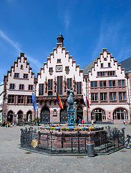 Statue and fountain with Rathaus or Town hall to rear in historic Romerberg Square in Frankfurt Hessen Germany