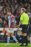 Conor Hourihane (Aston Villa) following his goal with Graham Scott (Referee) during the EFL Cup match between Brighton and Hove Albion and Aston Villa at the American Express Community Stadium, Brighton and Hove, England on 25 September 2019.