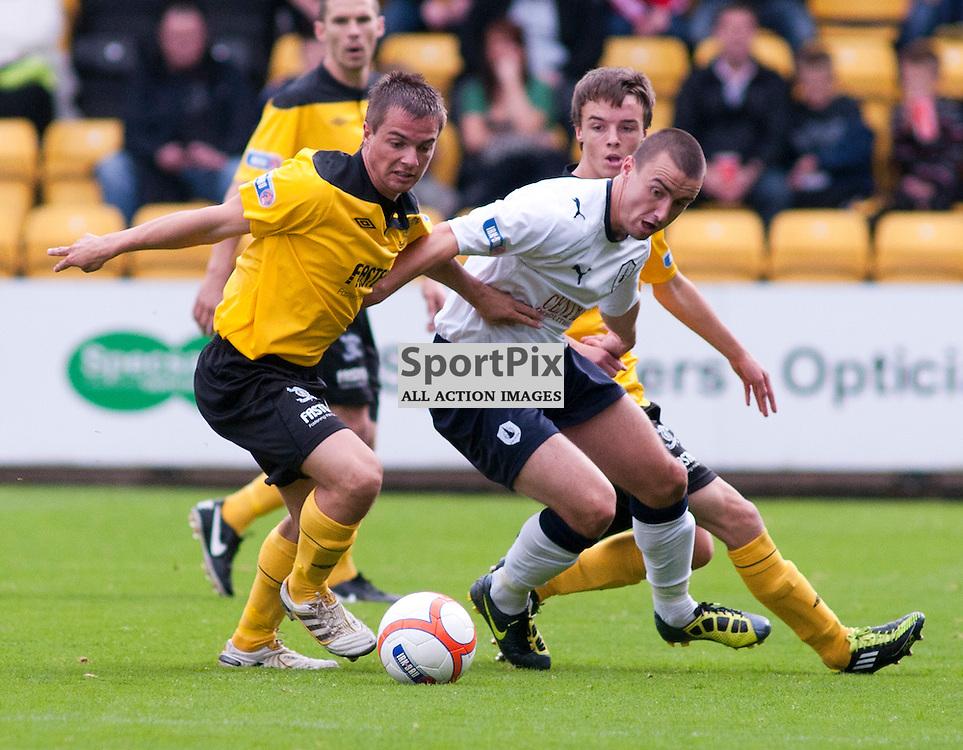 Livingston's Keaghan Jacobs tussle with Mark Millar, Livingston v Falkirk, SFL Division 1