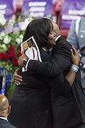 Mourners embrace during the funeral service for slain State Senator Clementa Pinckney at the TD Arena June 24, 2015 in Charleston, South Carolina. Pinckney is one of the nine people killed in last weeks Charleston church massacre.