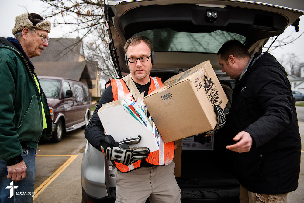 Stephen Born, regional disaster-response coordinator for the LCMS Central Illinois District (CID), carries emergency supplies given by the Rev. Michael Meyer, manager of LCMS Disaster Response, during a volunteer event for cleanup of flood-damaged homes on Saturday, Jan. 9, 2016, in Watseka, Ill. A flood at the end of December ravaged over a 60-block radius of the town. LCMS Communications/Erik M. Lunsford