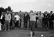 19/08/1967<br /> 08/19/1967<br /> 19 August 1967<br /> Irish Dunlop £1,000 Tournament at Tramore Golf Club, Co. Waterford. A Skerritt (Waterford) watches Christy O'Connor dive off at the 17th hole.