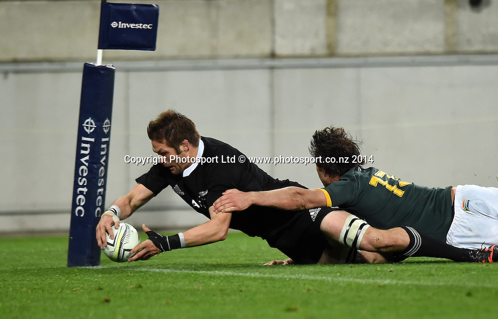 Richie McCaw scores a try in the corner in the tackle of Jan Serfontein. New Zealand All Blacks versus South Africa Springboks. The Rugby Championship. Rugby Union Test Match. Wellington. New Zealand. Saturday 13 September 2014. Photo: Andrew Cornaga/www.Photosport.co.nz