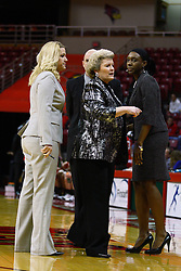30 December 2010: Redbird Coaches Sheila Roux, Travis Cantrell, Stephanie Glance and Daniell Santos huddle at a time out during an NCAA Womens basketball game between the Bradley Braves and the Illinois State Redbirds at Redbird Arena in Normal Illinois.