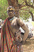 Africa, Ethiopia, Debub Omo Zone, Mursi tribesmen. A nomadic cattle herder ethnic group located in Southern Ethiopia, close to the Sudanese border. A warrior