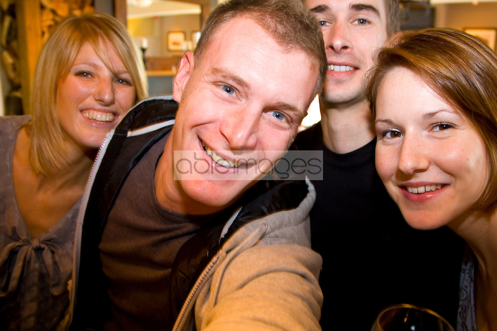 Close up of a group of friends taking a photograph of themselves
