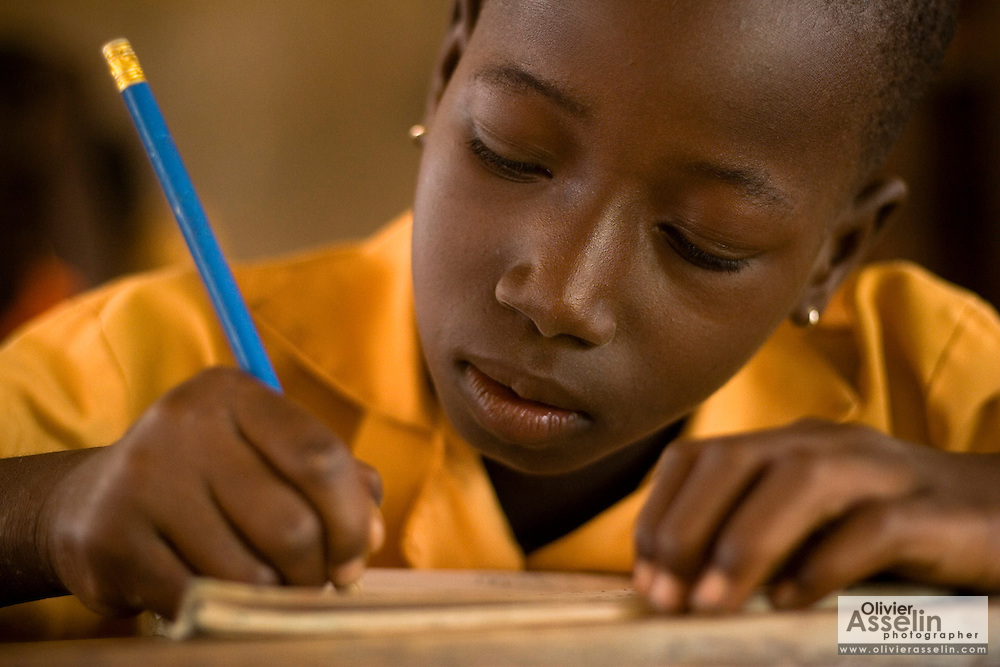 A girl writes in her workbook during class at the Ying Anglican Primary School in the Savelugu-Nanton district, northern Ghana on Monday June 4, 2007.