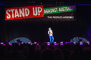 Kate Smurthwaite, evening compare. <br /> The Peoples Assembly  presents: Stand Up Against Austerity. Live at the Hammersmith Apollo. London. © Andrew Aitchison / Peoples Assembly