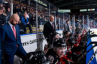 KELOWNA, BC - FEBRUARY 15: Red Deer Rebels coaches Brad Flynn, Brent Sutter and Ryan Colville stand on the bench against the Kelowna Rockets at Prospera Place on February 15, 2020 in Kelowna, Canada. (Photo by Marissa Baecker/Shoot the Breeze)