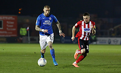 Marcus Maddison of Peterborough United in action with Joe Morrell of Lincoln City - Mandatory by-line: Joe Dent/JMP - 01/01/2020 - FOOTBALL - Sincil Bank Stadium - Lincoln, England - Lincoln City v Peterborough United - Sky Bet League One