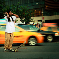 A young skateboarder practicing in Union Square. Manhattan,  New York City.