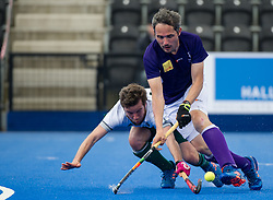 Sevenoaks' Duncan Parnis is tackled by Edward Welch of Canterbury. Canterbury v Sevenoaks - Men's Hockey League Finals, Lee Valley Hockey & Tennis Centre, London, UK on 23 April 2017. Photo: Simon Parker