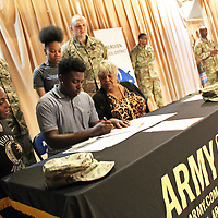 Aberdeen High School senior Stephen Murray signs his commitment to the U.S. Army as part of the school's first military signing day.