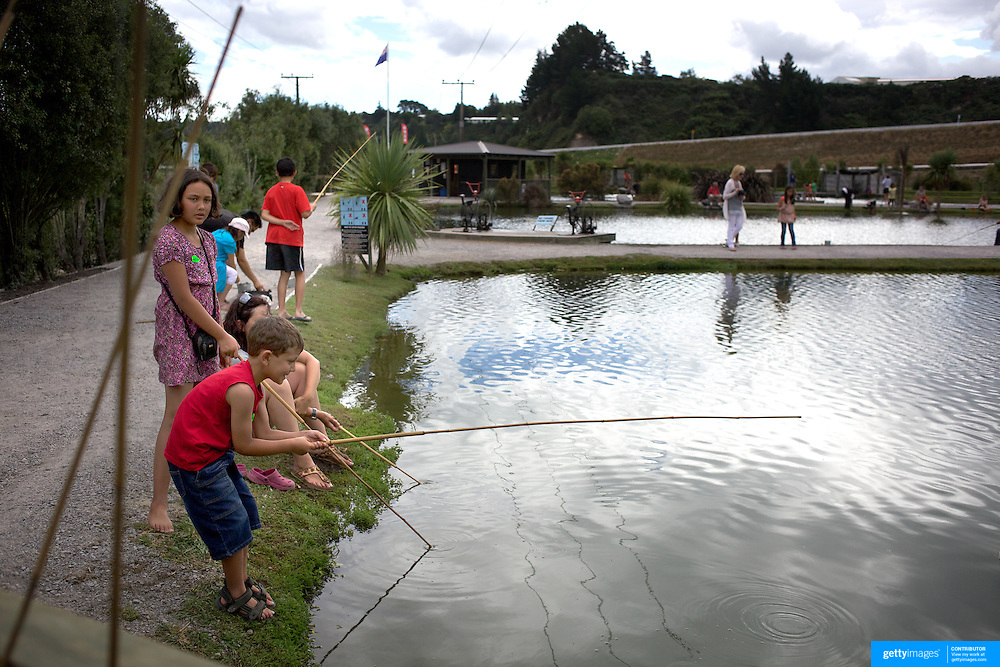 Youngsters fishing for prawns at the Huka Prawn Park,  Huka Falls Road, Taupo, New Zealand,, 7th January 2011 Photo Tim Clayton.