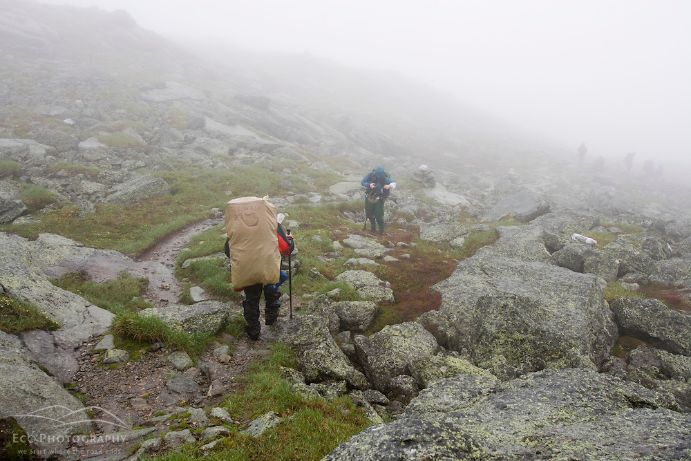 Hikers in the rain on Mount Washington in New Hampshire's White Mountains.