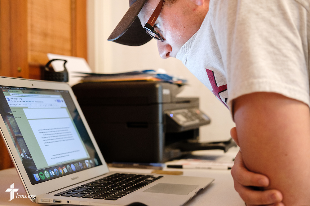 Young Adult Corps participant Paul Mroczenski researches Bible verses and writes about them on Tuesday, April 3, 2018, at Camp Restore in Baton Rouge, La. LCMS Communications/Erik M. Lunsford