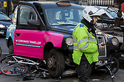 The aftermath of a black London taxi crashed into bike lock-up bars in Westminster, on 19th February 2019, in London, England.