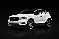 White 2019 Volvo XC40 T5 AWD R-Design Luxury car SUV isolated on black studio background with clipping path