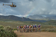 Leaders of the masters and grand-master category ride together with a rainbow forming in the background during stage 3 of the 2014 Absa Cape Epic Mountain Bike stage race held from Arabella Wines in Robertson to The Oaks Estate in Greyton, South Africa on the 26 March 2014<br /> <br /> Photo by Greg Beadle/Cape Epic/SPORTZPICS Global sport and corporate event photography by Greg Beadle. Greg captures the energy and emotion of international events including the World Economic Forum, Tour de France, Cape Epic MTB and the Cape Town Cycle Tour