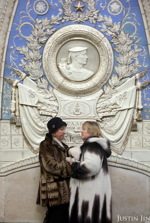 Women hold hands at the Taganskaya metro station on the Moscow Ring line. .The Moscow Metro, which spans almost the entire Russian capital, is the world's second most heavily used metro system after the Tokyo's twin subway. Opened in 1935, it is well known for the ornate design of many of its stations, which contain outstanding examples of socialist realist art.