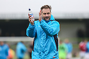 Forest Green Rovers assistant manager, Scott Lindsey applauds the fans during the Vanarama National League match between Forest Green Rovers and Wrexham FC at the New Lawn, Forest Green, United Kingdom on 18 March 2017. Photo by Shane Healey.