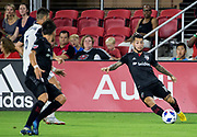 WASHINGTON, DC - AUGUST 29: D.C. United midfielder Luciano Acosta (10) sends over a pass during a MLS match between D.C United and the Philadelphia Union on August 29, 2018, at Audi Field, in Washington, DC. <br /> The Philadelphia Union defeated DC United 2-0.<br /> (Photo by Tony Quinn/Icon Sportswire)