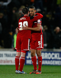Bristol City's Lewin Nyatanga and Matthew Bates celebrate the draw- Photo mandatory by-line: Matt Bunn/JMP  - Tel: Mobile:07966 386802 19/04/2013 - Hull City v Bristol City - SPORT - FOOTBALL - Championship -  Hull- KC Stadium