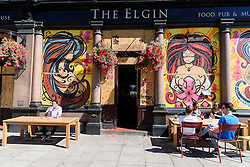 © Licensed to London News Pictures. 26/08/2016. Eigin pub is boarded up in Notting Hill ahead of the annual Notting Hill Carnival which starts this bank holiday weekend.  London, UK. Photo credit: Ray Tang/LNP
