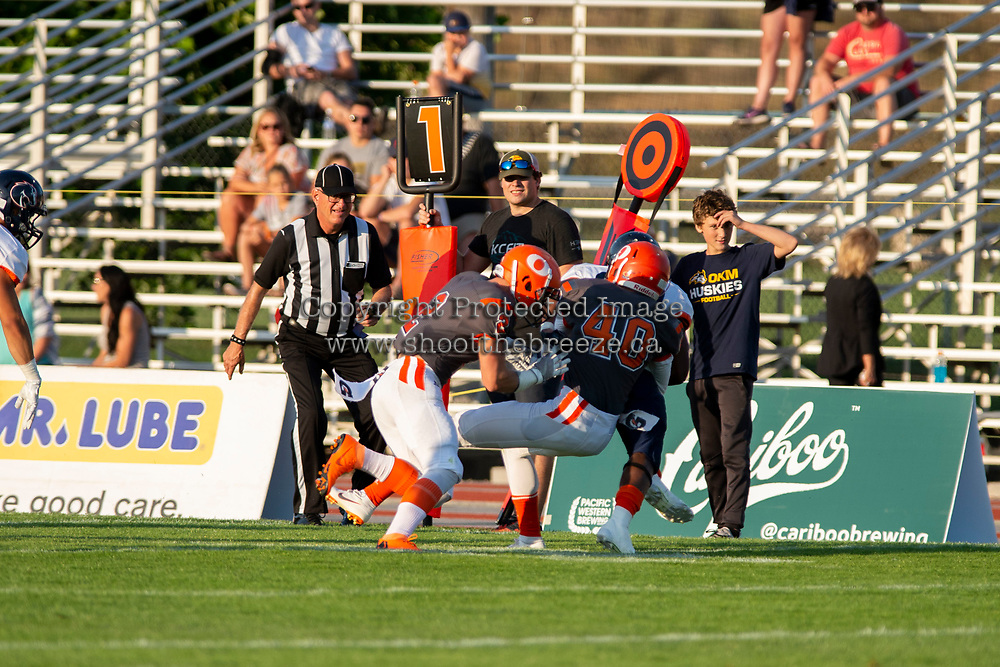 KELOWNA, BC - AUGUST 3:  Garrett Cape #2 and Liam Johnstone #40 of Okanagan Sun tackle Cameron Wright QB #10 of Kamloops Broncos at the sidelines at the Apple Bowl on August 3, 2019 in Kelowna, Canada. (Photo by Marissa Baecker/Shoot the Breeze)